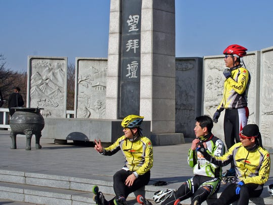 Roller bladers relax at the Mangbaedan, an altar for