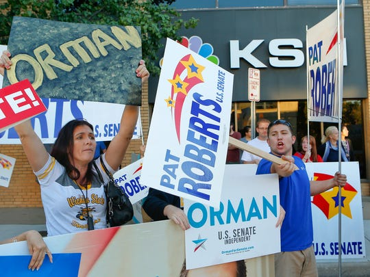 Supporters of independent Senate candidate Greg Orman