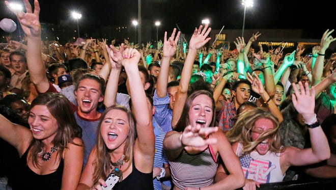 Students scream to music from Live Nation during the ASU Residential Hall Association Tiki Luau Monday, August 17, 2015 in Tempe, Ariz.