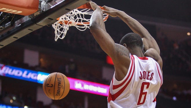 Houston Rockets power forward Terrence Jones (6) dunks the ball during the first quarter against the Miami Heat.