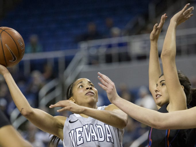 Nevada's Ari Wideman shoots over Boise State's Brooke Pahukoa during their basketball game at Lawlor Events Center in Reno, Nevada on Tuesday night, March 4, 2014.