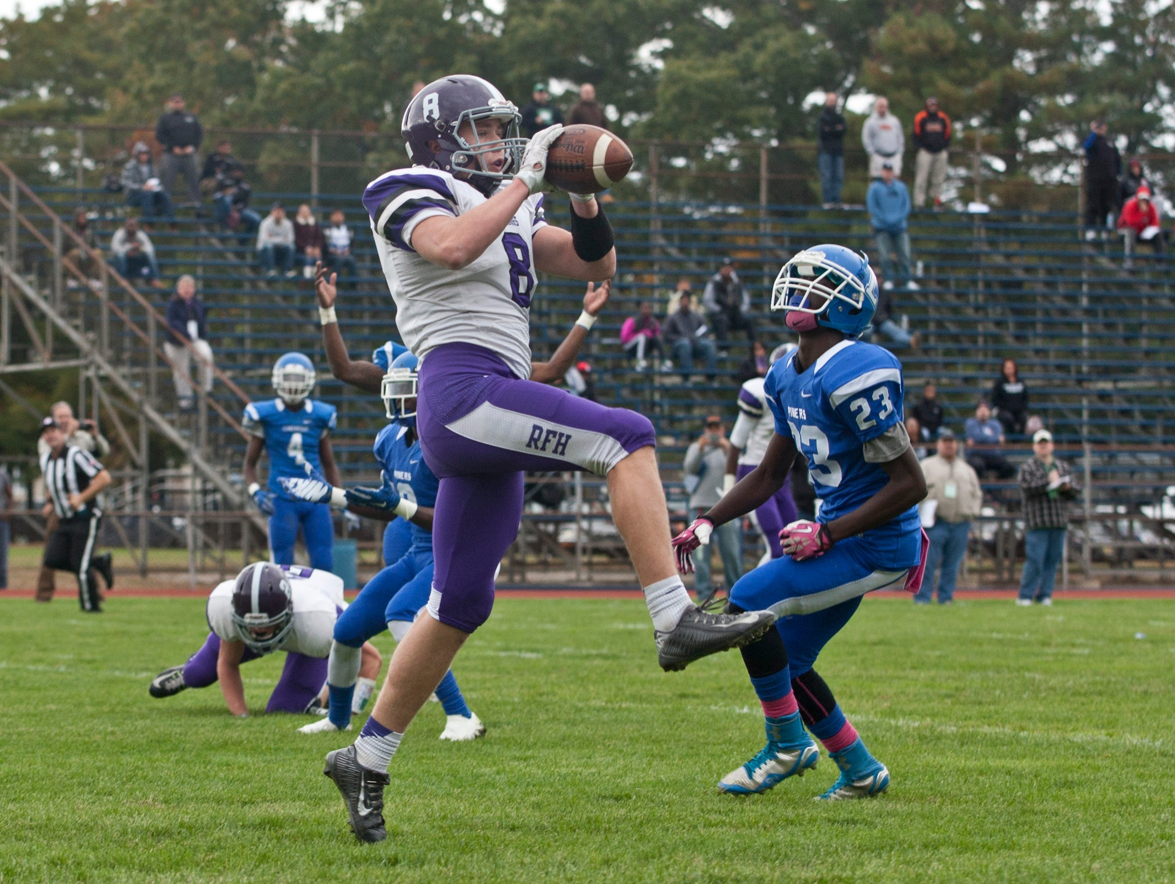 Rumson's Jack Kingdon pulls in a pass in the endzone for his team's third toudhdown during Rumson-Fair Haven Football vs Lakewood in Lakewood, NJ on October 24, 2015