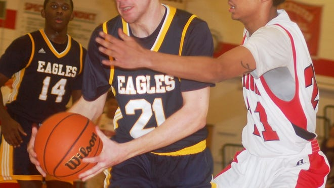 Eastern Christian sophomore Jared Post (21) is one of the up-and-coming players on the Eagles' boys basketball team.
