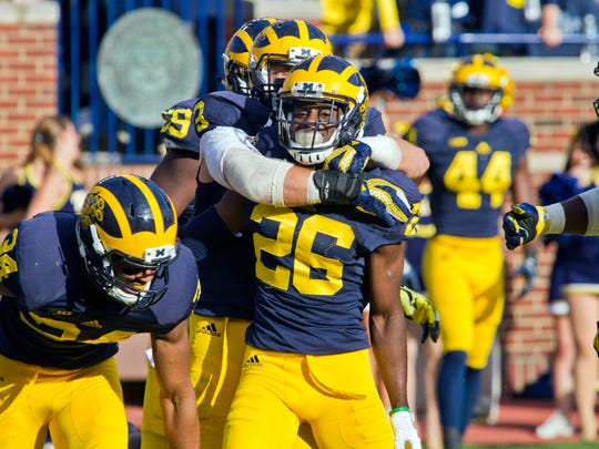 Michigan defensive back Jourdan Lewis (26) celebrates with teammates after scoring a touchdown on an interception last week against Northwestern. Lewis is likely to be opposite MSU's Aaron Burbridge Saturday.