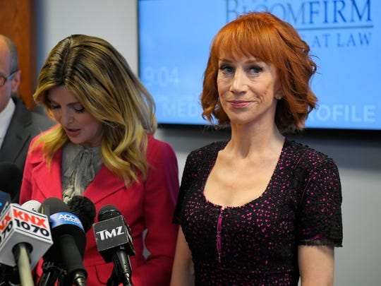 Comedian Kathy Griffin, right, speaks along with her attorney Lisa Bloom during a June 2 new conference in Los Angeles. They discussed the backlash since Griffin released a photo and video of her displaying a likeness of President Donald Trump's severed head.