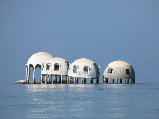 Fate of partly submerged dome home near Marco shifts, now up