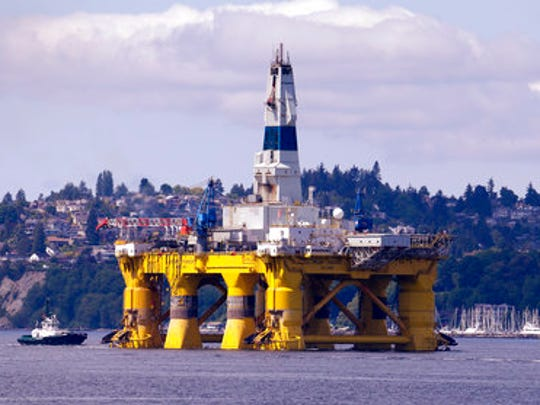 FILE - In this May 14, 2015 file photo, the oil drilling rig Polar Pioneer is towed toward a dock in Elliott Bay in Seattle. Working to dismantle his predecessor's environmental legacy, President Donald Trump signed an executive order on Friday, April 28, 2017, aimed at expanding drilling in the Arctic and opening other federal areas to oil and gas exploration.