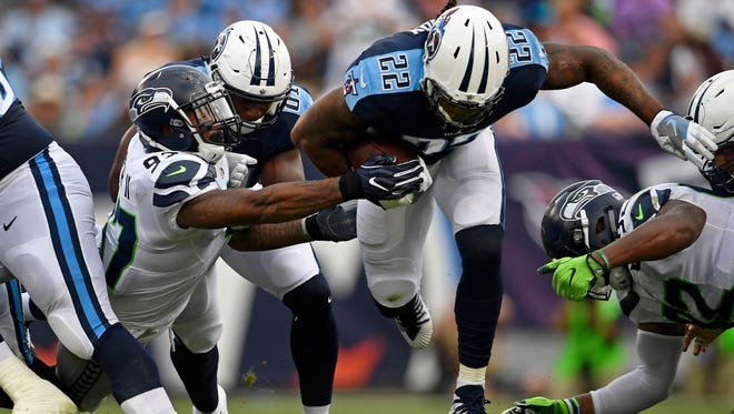 Titans running back Derrick Henry (22) runs for some of his 54 yards against the Seahawks on Sunday, Sept. 24, 2017, at Nissan Stadium.