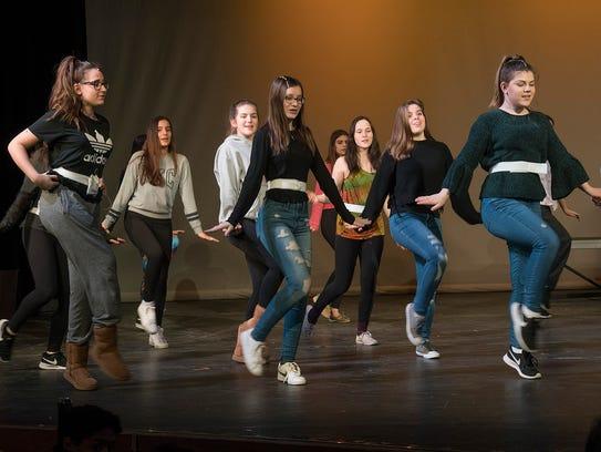 The cast of Bye, Bye, Birdie, rehearses dance numbers.