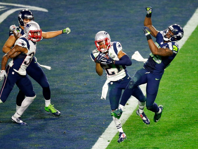 Patriots corner back Malcolm Butler intercepts a pass