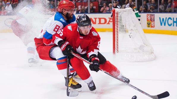 Team Canada's Brad Marchand (63) and Team Russia's Alex Ovechkin (8) during the third period of a World Cup of Hockey semifinal game, Saturday, Sept. 24, 2016 in Toronto. (Nathan Denette/The Canadian Press via AP)