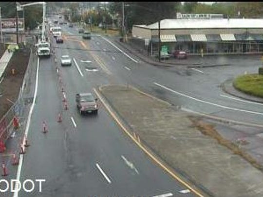 A lane closure on Wallace Road NW slows traffic Wednesday morning.