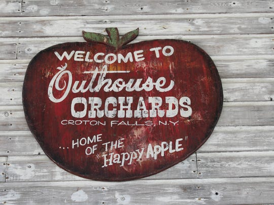 The farm sign in the store at Outhouse Orchards on
