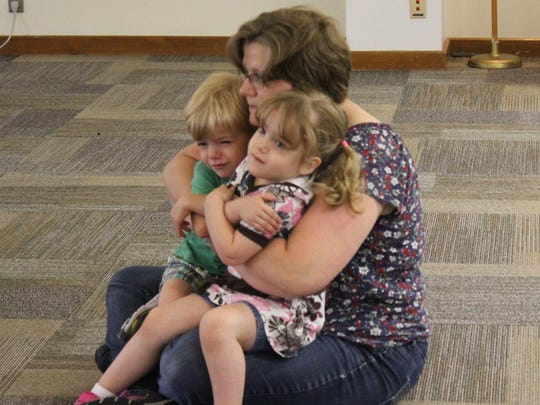 Malinda McGranahan hugs her son Ryan and daughter Ellora, both 3, during the final song of the Music Together of Galloway class at the Mays Landing library.