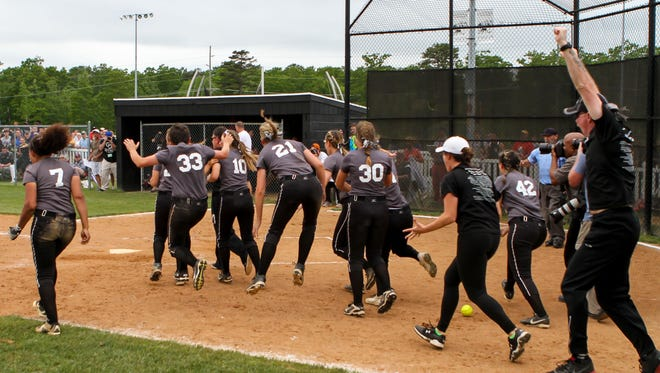 Eht girls softball team reacts after coming back to win against Eastern Regional 7-6 in 13 innings for the South Jersey Group IV title. Friday, June 3, 2016, Egg Harbor Township, NJ.