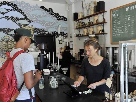Julia Callis waits on Stephanie Blair at The Red Hook, a coffee shop on Agnes in West Village, an area where officials hope to spur new development.