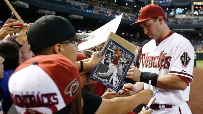 Diamondbacks' Paul Goldschmidt signs autographs on Friday, June 19, 2015 at Chase Field in Phoenix.