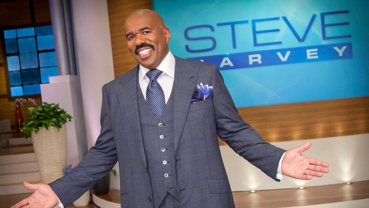 """Host Steve Harvey stands on the set of his talk show """"The Steve Harvey Show,"""" in Chicago."""