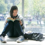 Kany Keita, 15, reads during lunch at Bioscience High School.