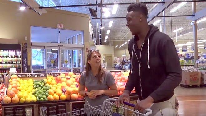 Amanda Poppleton tours a grocery store with North Carolina State basketball player Abdul-Malik Abu.