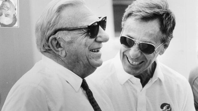 Tampa Bay Buccaneers owner Hugh Culverhouse, left, and general manager Phil Krueger laugh during NFL football practice in Tampa. Krueger, who helped build a dominant defense as an assistant for 1967 national champion Southern California and later became part of the first coaching staff in Buccaneers' history, died Monday at his home in Pembroke Pines. He was 90. Krueger coached offense, defense and special teams during more than three decades in the NFL and college.