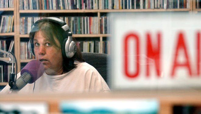 Cindy Reich of KRFC broadcasts the `Long Acre' show featuring Celtic music at its S. College Ave. studio in 2003.