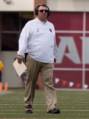 Arkansas Razorbacks head coach Bret Bielema walks on the field during a timeout in the game between the Razorbacks and the UTEP Miners at Donald W. Reynolds Razorback Stadium.