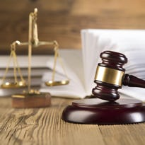 Scales of justice, gavel and books.