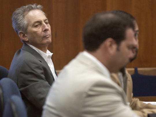 In this Aug. 18, 2003 file photo, Robert Durst (L) sits in a courtroom during a pre-trial hearing at the Galveston County Courthouse in Galveston, Texas.