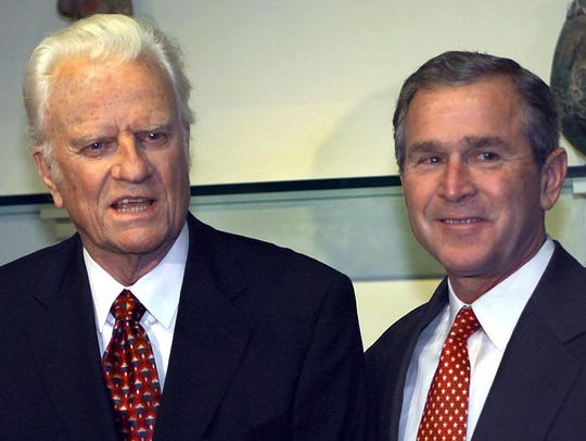 The Rev. Billy Graham, left, announces his support