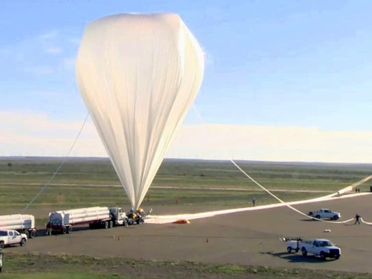 A crew readies a balloon for launch with it's payload
