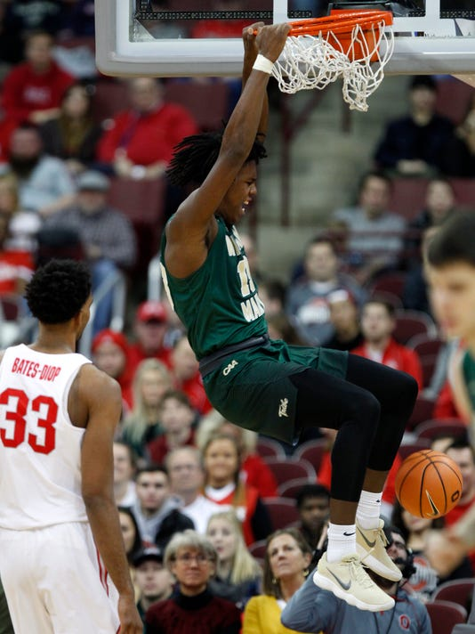 William & Mary forward Nathan Knight, right, dunks the ball against Ohio State forward Keita Bates-Diop during the second half of an NCAA college basketball game in Columbus, Ohio, Saturday, Dec. 9, 2017. Ohio State won 97-62. (AP Photo/Paul Vernon)