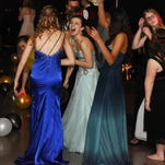 Santiam High School students celebrate their masquerade themed prom at the Gates Fire Hall on Saturday April 25.