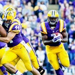 LSU RB Leonard Fournette (7) barrels through an opening for a gainer in the football game between LSU and Eastern Michigan at Tiger Stadium in Baton Rouge, Louisiana on October 03, 2015. Photo: Michael O. Curley