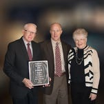 Dr. Michael Colip (center) is pictured with his parents.