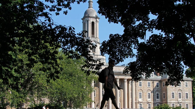 A student walks at Penn State University. A study found that grads with degrees in math, science, technology or engineering were paid better than grads with other degrees.