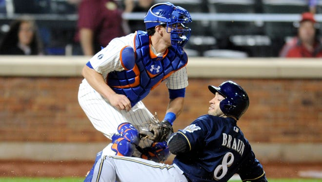 The Mets' Taylor Teagarden, left, tags out Milwaukee's Ryan Braun attempting to score on a double by Jonathan Lucroy in the seventh inning on Wednesday at Citi Field.