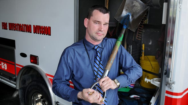 William H. Beale, the Dutchess County assistant emergency response coordinator, stands next to the Fire Investigation Division command vehicle. Beale said that tools such as shovels and rakes are key when his team is sifting through debris to determine the cause of a fire. The tools are carefully cleaned after each investigation to avoid any contamination from a previous fire.