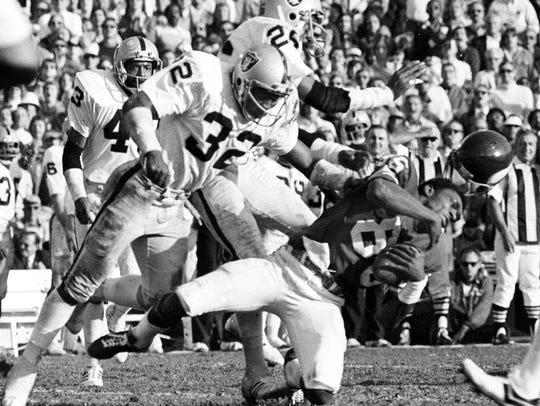 Raiders' Jack Tatum (32) of Passaic hitting Vikings