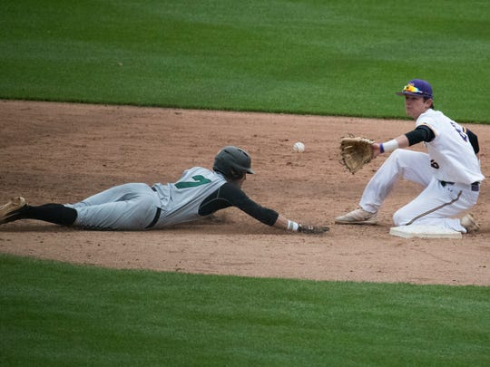 Wilmington's Kendall Small (7) dives back to second base during the Bill Giles Invitational against West Chester last year at Citizens Bank Park. Wilmington defeated West Chester 6-1.