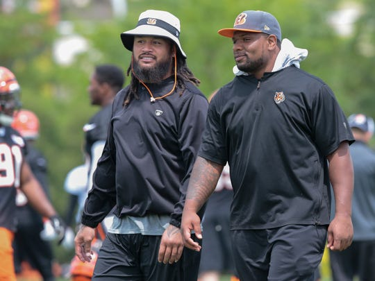 Cincinnati Bengals middle linebacker Rey Maualuga (58), left, and outside linebacker Vontaze Burfict (55) did not participate during Cincinnati Bengals organized team activities, Tuesday, June 7, 2016, at the practice field next to Paul Brown Stadium in Cincinnati.