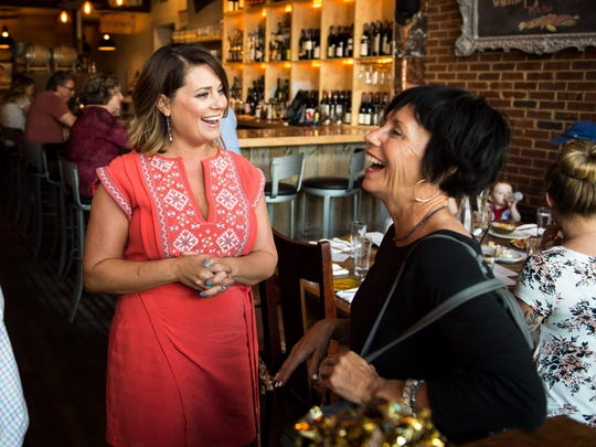 Manager Cara Graham, left, greets guests including LaRae Davenport, right, during community hour at Lockeland Table, Tuesday, Nov. 1, 2016, in Nashville, Tenn. Community hour is from 4-6pm and a portion of the proceeds go to the Lockeland Design Center PTO.