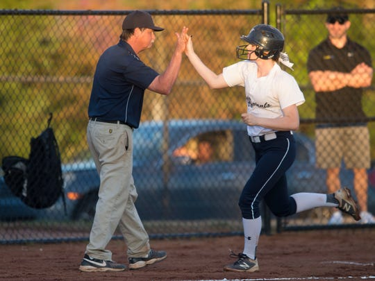 Farragut's Lexee Lamoree is cheered on by coach David Moore after hitting a home run against Bearden in 2017.
