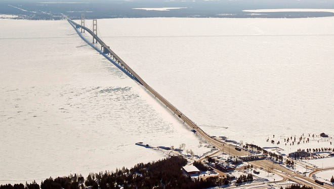 This Feb. 11, 2014, aerial file photo shows a view of the Mackinac Bridge, which spans a 5-mile-wide freshwater channel called the Straits of Mackinac that separates Michigan's upper and lower peninsulas.