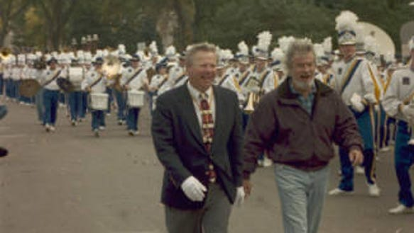 SDSU band director Jim McKinney (left) is joined by
