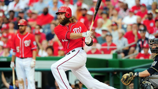 Washington Nationals outfielder Jayson Werth (28) hits the game-winning RBI double in the ninth inning against the Milwaukee Brewers at Nationals Park.