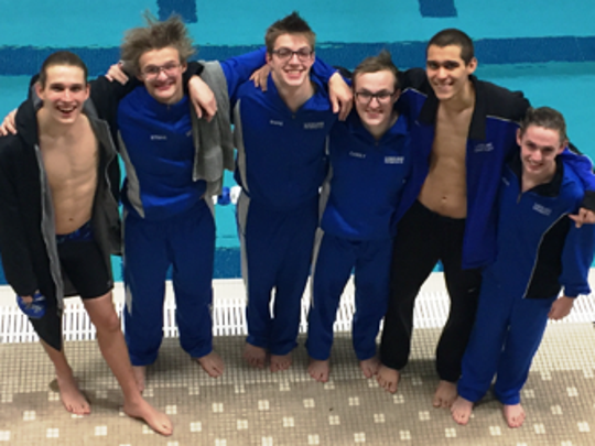 Lakeland seniors get together after a dual meet with Milford.