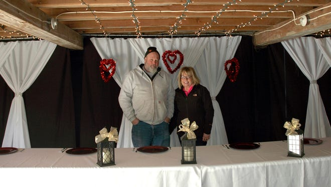 In this Feb. 2, 2017 photo, Brad and Carla Miller stand inside their dairy barn that they  transformed along with the surrounding grounds into The Barn on the Hill, for weddings, rehearsals, showers, class reunions, anniversary and birthday parties in Leaf River, Ill. Their daughter's wedding inspired the retired teachers to turn their century-old dairy barn into an event venue.