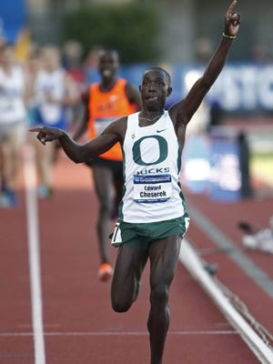Oregon's Edward Cheserek used a powerful final lap kick to win the mens 10,000 meter run in the time of28:30.18 on the first day of theNCAA Division 1 Outdoor Track & Field Championships at Hayward Field, in Eugene, on Wednesday,  June 11, 2014.