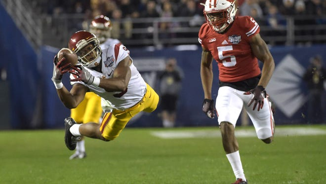 USC wide receiver JuJu Smith-Schuster (9) attempts to catch a pass while defended by Wisconsin cornerback Darius Hillary during the 2015 Holiday Bowl at Qualcomm Stadium in San Diego. Dec 30, 2015; San Diego, CA, USA; Southern California Trojans wide receiver JuJu Smith-Schuster (9) attempts to catch a pass while defended by Wisconsin Badgers cornerback Darius Hillary (5) during the 2015 Holiday Bowl at Qualcomm Stadium. Mandatory Credit: Kirby Lee-USA TODAY Sports